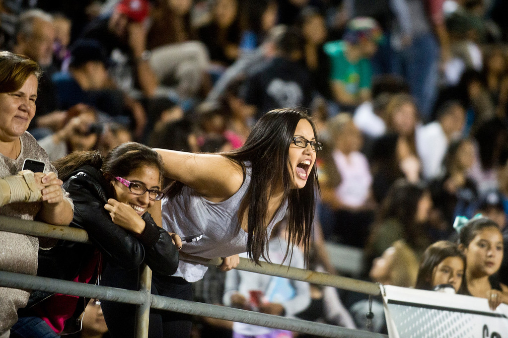 . Fans cheer for Patrick Cordova, 16, a transgender senior who is running for Azusa High 2013 Homecoming Queen during halftime of the homecoming game at Citrus College Stadium in Glendora on Friday night, Sept. 27, 2013.( Photo by Watchara Phomicinda/ San Gabriel Valley Tribune)