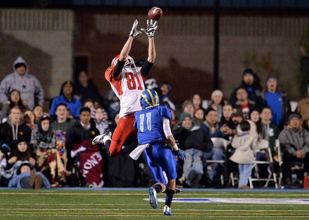 . Paraclete\'s Chad Hall (81) catches a pass for a touchdown over San Dimas\' Erick Ware (11) in the second half of a CIF-SS Mid-Valley Division championship football game at San Dimas High School in San Dimas, Calif., on Friday, Dec. 6, 2013. San Dimas won 20-14.  (Keith Birmingham Pasadena Star-News)
