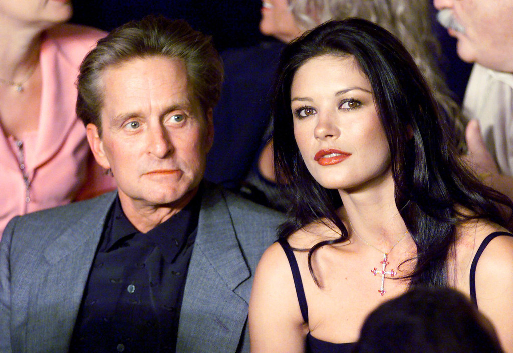 . Actors Michael Douglas and Catherine Zeta Jones sit together at ringside before the start of the WBC/IBF Welterweight Championship fight between Oscar De La Hoya and Felix Trinidad at the Mandalay Bay Events Center in Las Vegas Saturday, Sept. 18, 1999. (AP Photo/Kevork Djansezian)