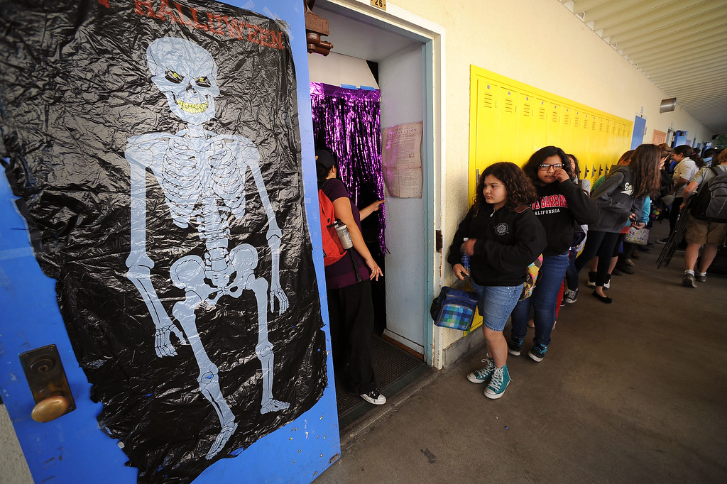 . Students at Millikan Middle School line up outside their classroom while participating in the Great American Shakeout in Sherman Oaks, CA, October 17, 2013.  (Andy Holzman/Los Angeles Daily News)