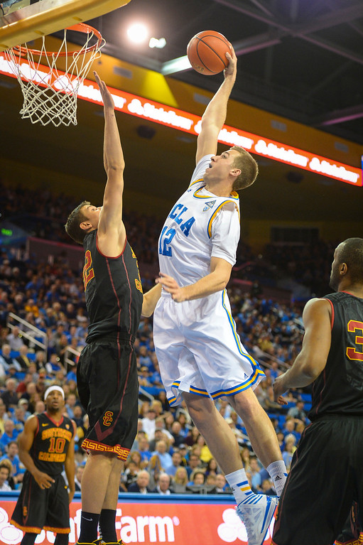 . UCLA�s David Wear slams in two points as USC�s Nikola Jovanovic defends on the play during game action at Pauley Pavilion Sunday, December 5, 2014. UCLA  defeated USC 107-73.  Photo by David Crane/Los Angeles Daily News.