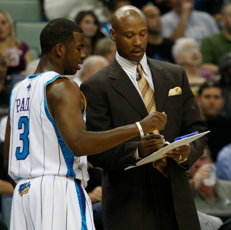 . New Orleans Hornets guard Chris Paul (3) and New Orleans Hornets coach Byron Scott talk during a break in the action in the first half of an NBA basketball game in New Orleans,  Wednesday, Nov. 4, 2009.  (AP Photo/Bill Haber)