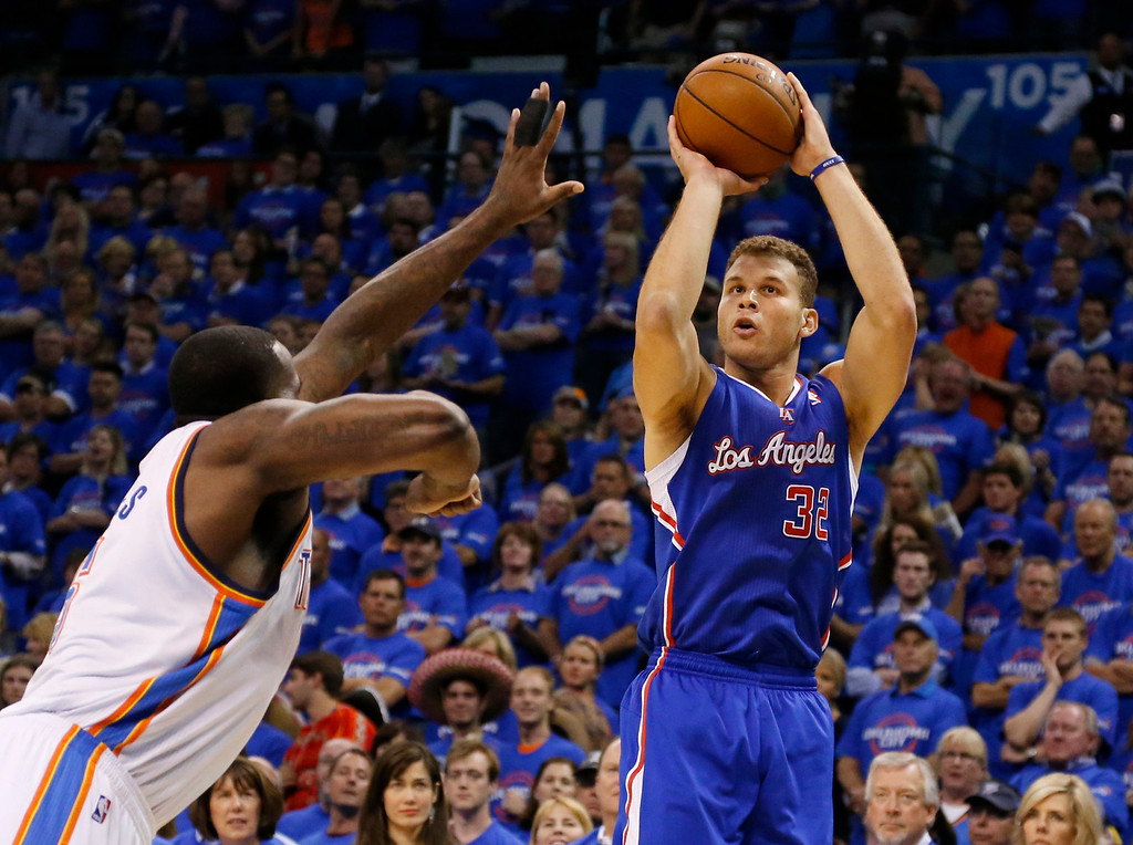 . Los Angeles Clippers forward Blake Griffin,right, shoots over Oklahoma City Thunder center Kendrick Perkins, left, in the first quarter of Game 1 of the Western Conference semifinal NBA basketball playoff series in Oklahoma City, Monday, May 5, 2014. (AP Photo/Sue Ogrocki)