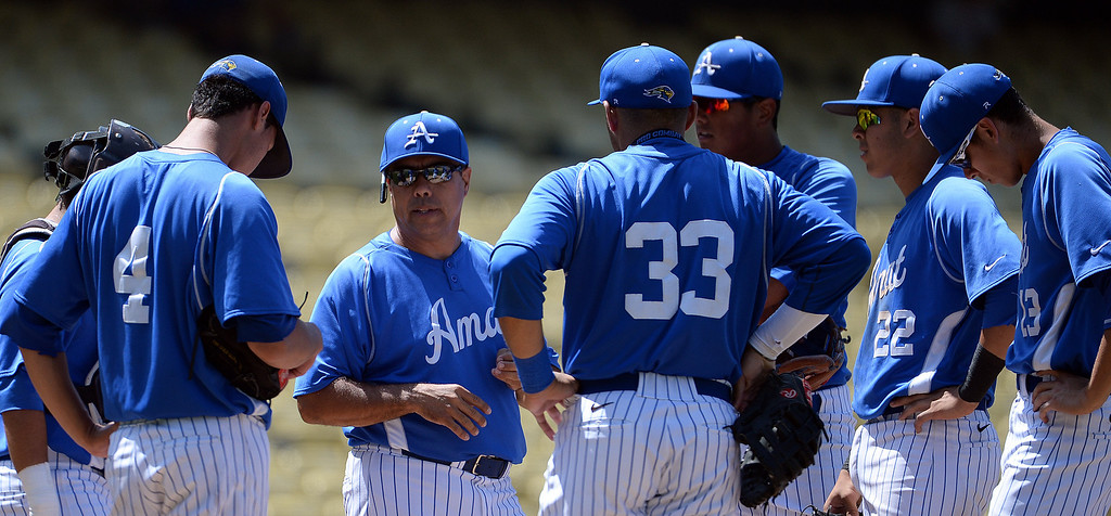 . Bishop Amat head coach Andy Nieto talks to his team on the mound in the third inning of the CIF-SS Division 3 baseball championship against Palm Desert at Dodger Stadium in Los Angeles on Friday, June 6, 2014. Bishop Amat won 4-3. 
