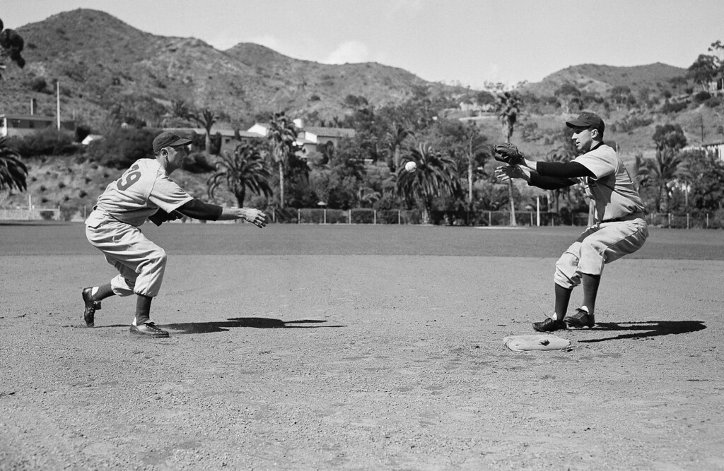 . Roy Smalley, left, Chicago Cubs shortstop, and Wayne Terwilliger, Cubs second baseman, practice up on a double play strategy at their spring training camp, Feb. 25, 1951, Avalon, Catalina Island, Calif. (AP Photo/HMP)