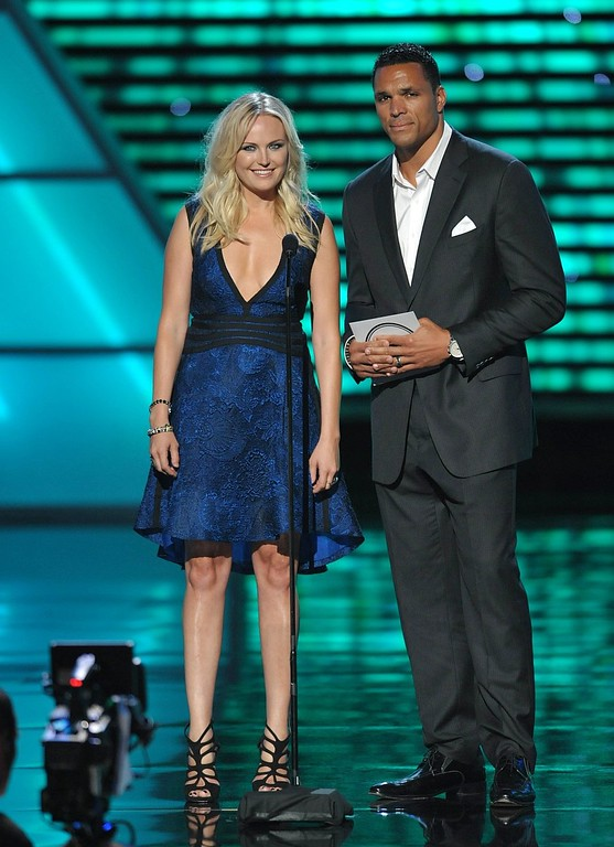 . Malin Akerman, left, and Tony Gonzalez present the award for best record-breaking performance at the ESPY Awards on Wednesday, July 17, 2013, at Nokia Theater in Los Angeles. (Photo by John Shearer/Invision/AP)