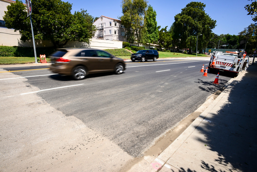 . Traffic flows over fresh asphalt along Sunset blvd. where a water main broke last week releasing thousands of gallons of water and closing the busy street until early Monday morning.   ( Photo by David Crane/Los Angeles Daily News )