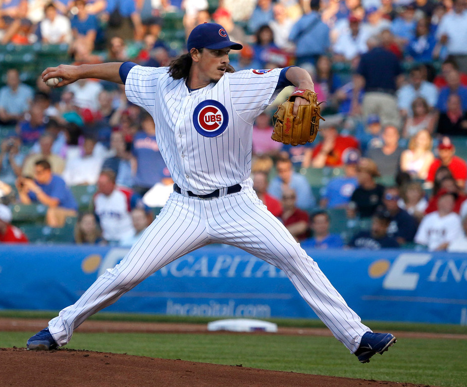 . Chicago Cubs starting pitcher Jeff Samardzija delivers during the first inning of an interleague baseball game against the Los Angeles Angels on Wednesday, July 10, 2013, in Chicago. (AP Photo/Charles Rex Arbogast)