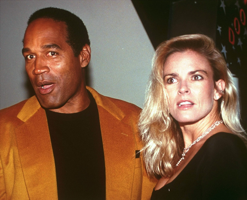 ". O.J. Simpson and his wife, Nicole Brown Simpson, celebrate the opening of the Harley-Davidson Cafe in this Oct. 19, 1993 file photo. O.J. Simpson created an uproar Wednesday, Nov. 15, 2006 with plans for a TV interview and book titled ""If I Did It\"".  Fox, which plans to air an interview with Simpson Nov. 27 and 29, said Simpson describes how he would have committed the 1994 slayings of his ex-wife, Nicole Brown Simpson, and her friend Ronald Goldman, \""if he were the one responsible.\"" (AP Photo/Paul Hurschmann)"