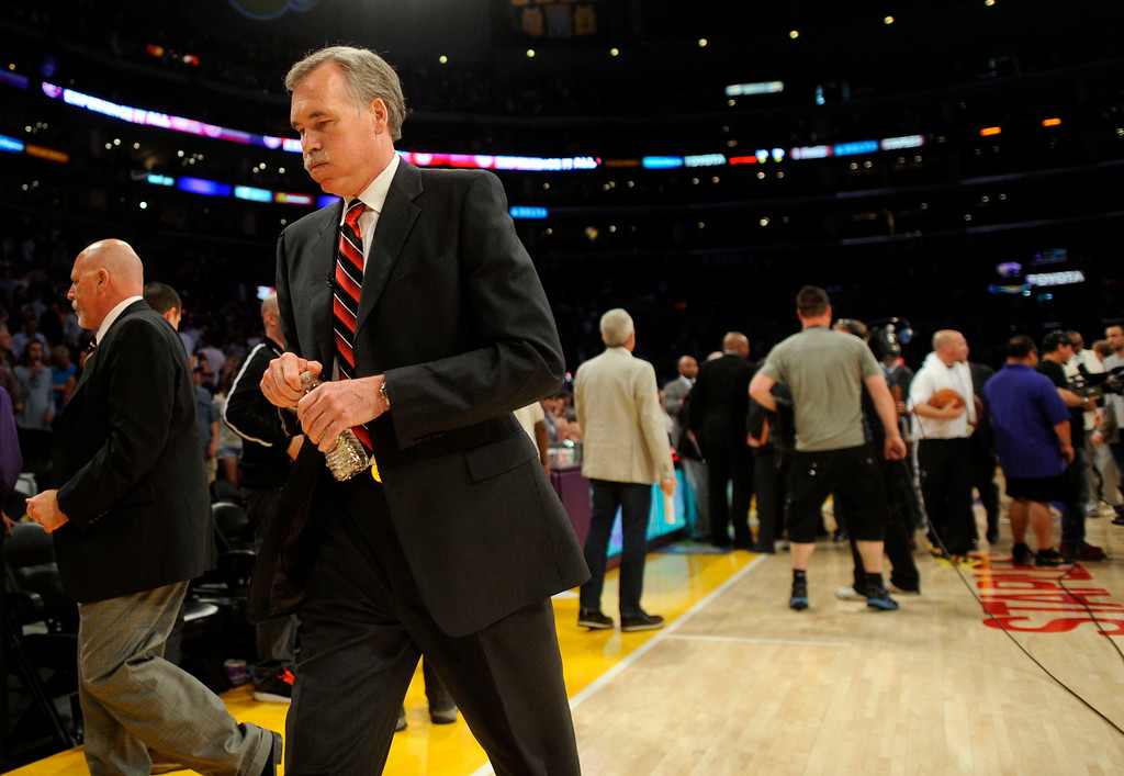. Lakers\' coach  Mike D\'Antoni walks to the locker room after game four of their NBA Western Conference playoffs at the Staples Center Saturday, April 28, 2013. The Spurs beat the Lakers 120-89. The Spurs beat the Lakers 103-82. (Hans Gutknecht/Los Angeles Daily News)
