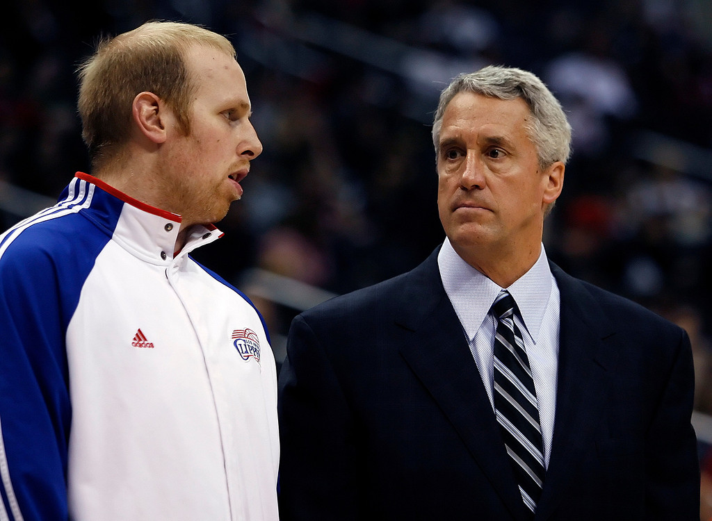 . Los Angeles Clippers center Chris Kaman talks with interim head coach Kim Hughes prior to playing against the San Antonio Spurs in an NBA basketball game, Saturday, Feb. 6, 2010, in Los Angeles. (AP Photo/Alex Gallardo)