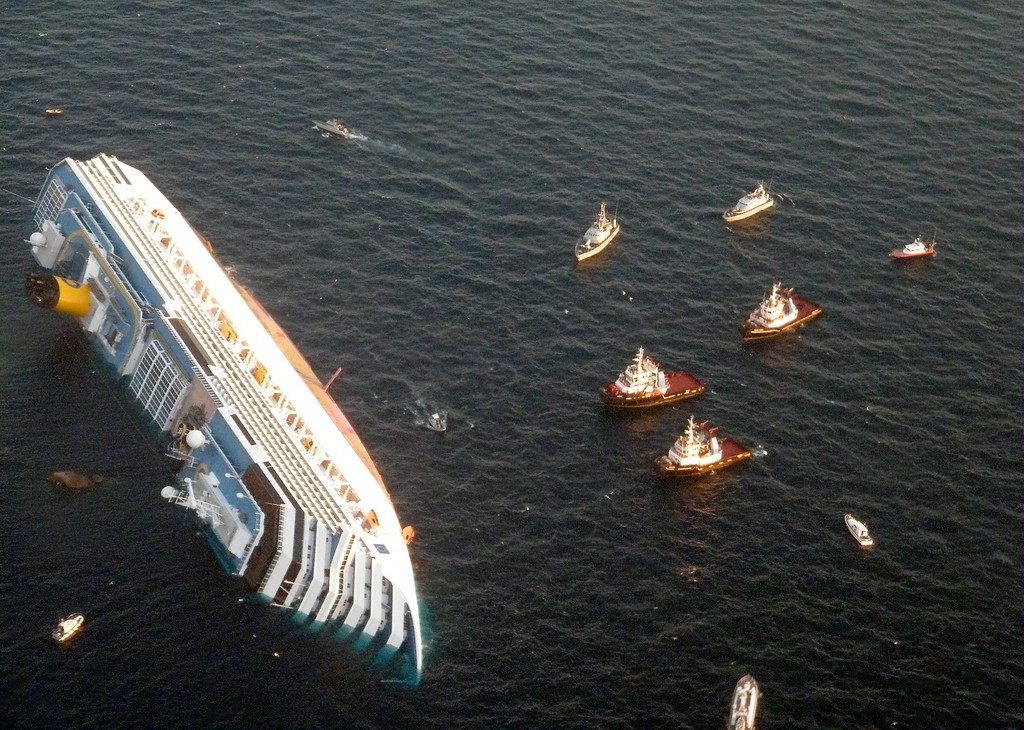 . In this Jan. 14, 2012 file photo released by the Guardia di Finanza (border Police), the luxury cruise ship Costa Concordia leans on its side after running aground off the tiny Tuscan island of Giglio, Italy.  The luxury cruise ship ran aground off the coast of Tuscany, sending water pouring in through a 160-foot (50-meter) gash in the hull and forcing the evacuation of some 4,200 people from the listing vessel early.  . (AP Photo/Guardia di Finanza, File)