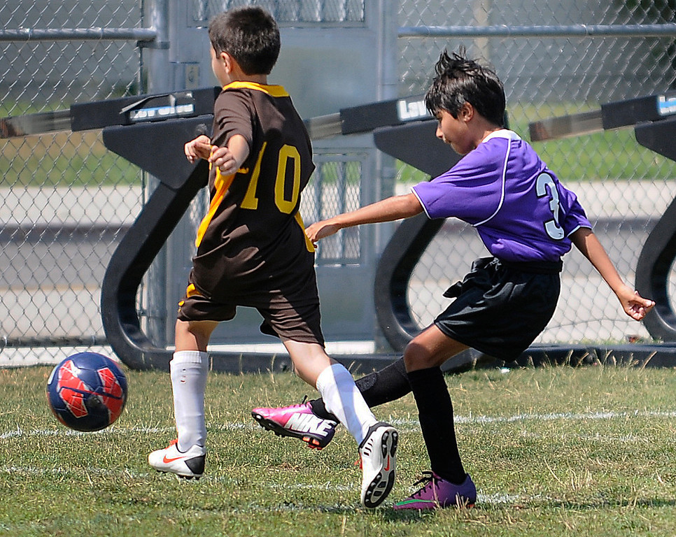 . Andrew Keshishian,#3 from the LA soccer club, kicks the ball past a Shant defender. The months-long Homenetmen Navasartian Games, an Armenian athletic competition that involves thousands of competitors, concluded Saturday at Birmingham High School in Van Nuys, CA. 7/6/2013(John McCoy/LA Daily News)