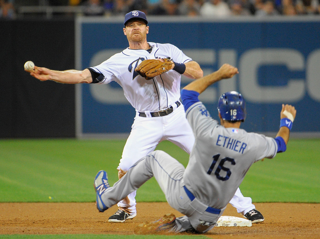 . Logan Forsythe #11 of the San Diego Padres throws over Andre Ethier #16 of the Los Angeles Dodgers to turn a double play during the sixth inning of a baseball game at Petco Park on June 20, 2013 in San Diego, California.  Padres won 6-3.   (Photo by Denis Poroy/Getty Images)