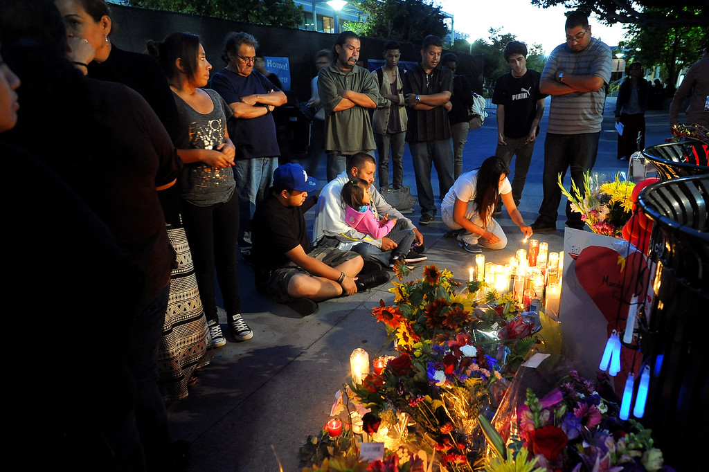 . Mourners gather around a memorial at Santa Monica College Monday, June 10, 2013.(Andy Holzman/Los Angeles Daily News)