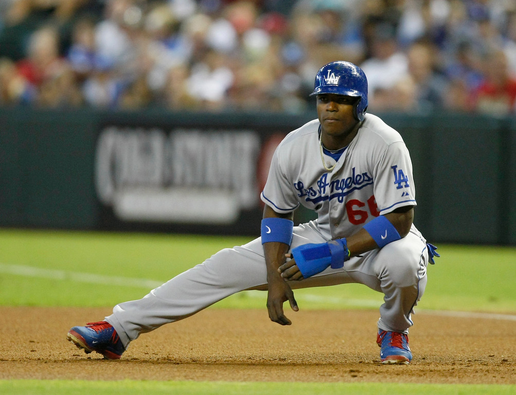. Los Angeles Dodgers Yasiel Puig (66) in the first inning during a baseball game against the Arizona Diamondbacks on Monday, July 8, 2013, in Phoenix. (AP Photo/Rick Scuteri)