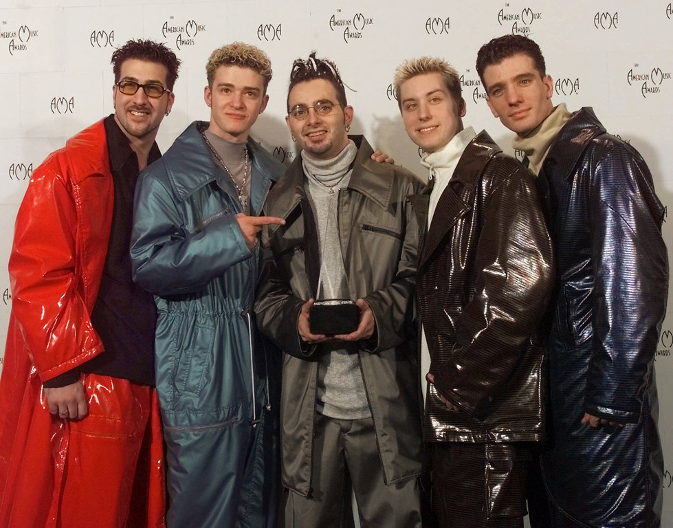 . Best new pop-rock group \'N Sync show off their trophy at the 26th Annual American Music Awards in Los Angeles, Monday, Jan. 11, 1999. (AP Photo/Mark Terrill)