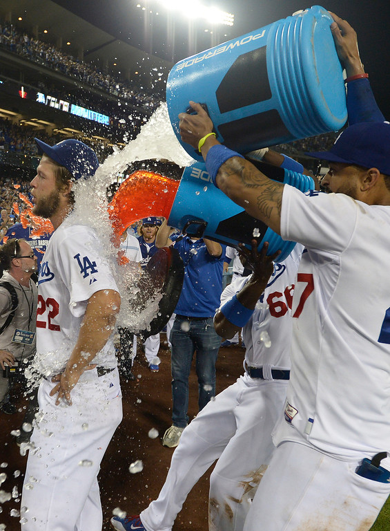 . Clayton Kershaw gets sports drink dumped on him by Yasiel Puig and Matt Kemp after he throws a no hitter. The Dodgers defeated the Colorado Rockies 8-0 at Dodger Stadium in Los Angeles, CA. 6/18/2014(Photo by John McCoy Daily News)