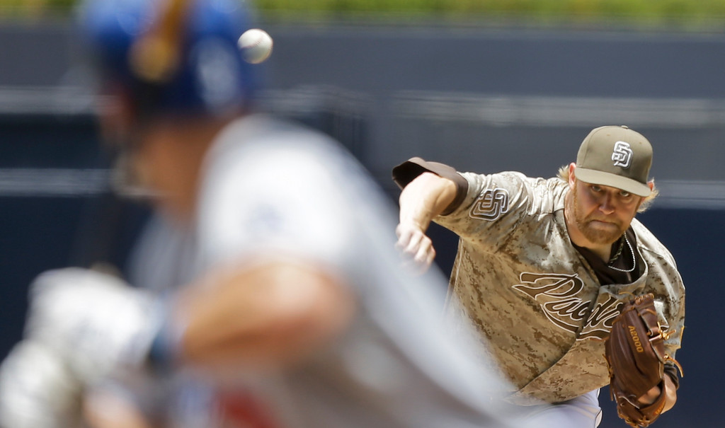 . San Diego Padres starting pitcher Andrew Cashner fires a pitch to Los Angeles Dodgers\' Skip Schumaker in the first inning of a baseball game in San Diego, Sunday, June 23, 2013. (AP Photo/Lenny Ignelzi)