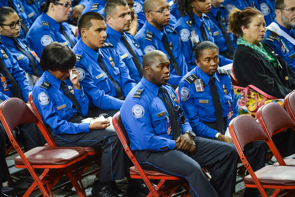 . Wounded TSA officer Tony Grigsby, center, and other TSA officers at the memorial for slain TSA officer Gerardo Hernandez at the Los Angeles Sports Arena Tuesday, November 12, 2013.  A public memorial was held for Officer Hernandez who was killed at LAX when a gunman entered terminal 3 and opened fire with a semi-automatic rifle, Grigsby was wounded in the attack.  ( Photo by David Crane/Los Angeles Daily News )