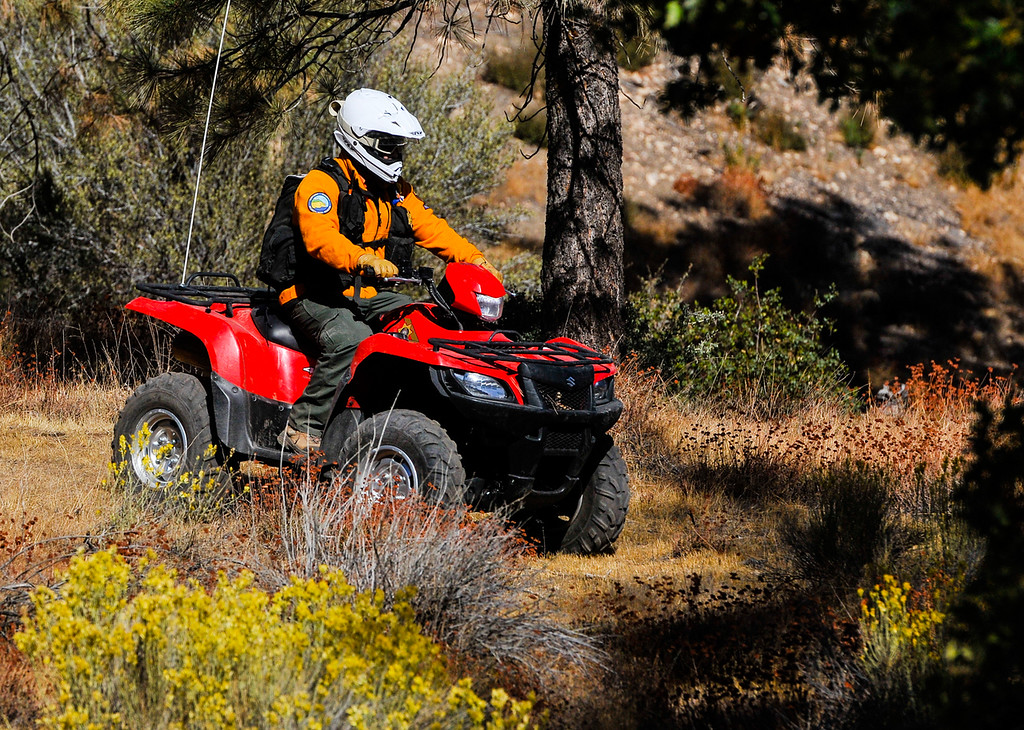. A San Bernardino County Sheriff\'s Department Search and Rescue crew member combs through the woods in effort to find a missing German hiker in the San Bernardino Mountains near Lake Arrowhead on Friday, Oct. 4, 2013. Alyof Krost, 62, went missing Tuesday afternoon after hiking with a group of 20 people on the Pinnacle Trail near Lake Arrowhead. (Photo by Rachel Luna / San Bernardino Sun)