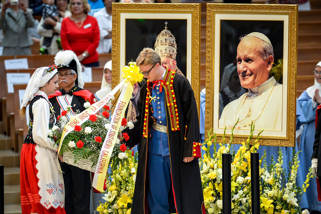 . Flowers are placed at a Mass of Thanksgiving in honor of the canonization of Saint John XXIII and Saint John Paul II at Our Lady of the Angels Sunday, April 27, 2014.   (Photo by David Crane/Los Angeles Daily News)
