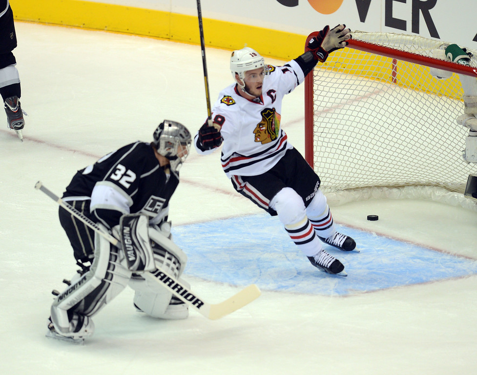 . The Blackhawks\' Bryan Bickell #29  skates past the Kings goalie Jonathan Quick  #32 after Bickell scored at 13:16 in the 1st period to make the score 1-1 during game 4 of the Western Conference finals at the Staples Center in Los Angeles June 6, 2013. (David Crane/Los Angeles Daily News)