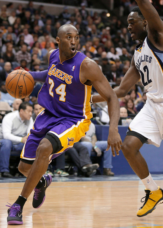 . In this Dec. 17, 2013, file photo, Los Angeles Lakers\' Kobe Bryant (24) dribbles around Memphis Grizzlies\' Jamaal Franklin (22) during the first half of an NBA basketball game in Memphis, Tenn. Bryant is expected to miss about six weeks with an injured left knee. The Lakers said Thursday, Dec. 19, that an MRI scan showed that Bryant has a fracture of the lateral tibial plateau of his knee. (AP Photo/Danny Johnston, File)