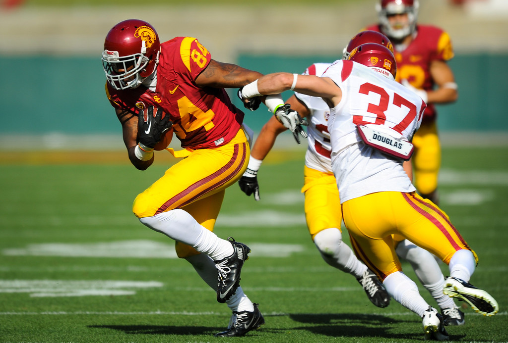 . USC WR Darreus Rogers tries to slip DB Matt Lopes at the spring game. (Photo by Michael Owen Baker/L.A. Daily News)