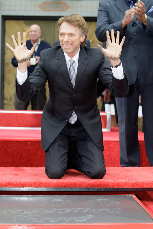 """. Movie and television producer Jerry Bruckheimer adds his hand and footprints to some 200 other celebrity impressions in the forecourt of Grauman\'s Chinese Theatre in the Hollywood district of Los Angeles Monday, May 17, 2010.  The ceremony comes 11 days before the release of Bruckheimer\'s latest film, \""""Prince of Persia: The Sands of Time.\""""  Bruckheimer\'s films have earned worldwide revenues of more than $15 billion in box office, home entertainment and music receipts and have garnered 41 Academy Award nominations and six Oscars.  (AP Photo/Reed Saxon)"""