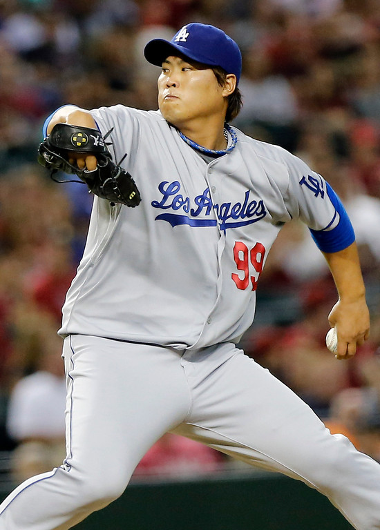 . Los Angeles Dodgers pitcher Hyun-Jin Ryu delivers a pitch against the Arizona Diamondbacks during the third inning of a baseball game, Wednesday, July 10, 2013, in Phoenix. (AP Photo/Matt York)