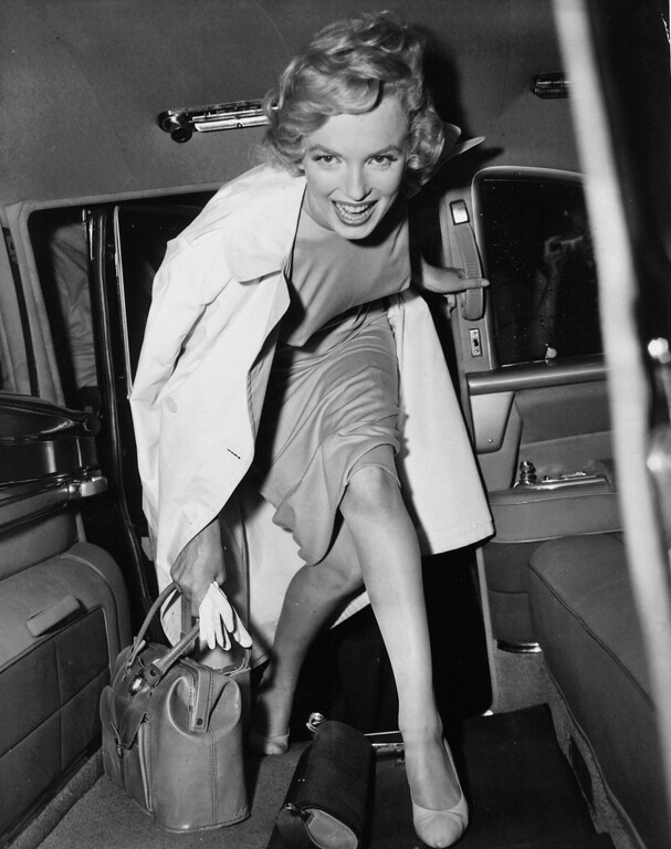 . Our undated picture shows Marilyn Monroe, smiling in car. (AP Photo)