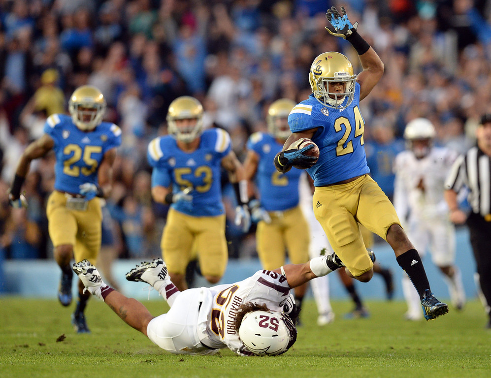 . UCLA�s Ishmael Adams #24 returns a kick off for a big gain during their game against Arizona State at the Rose Bowl Saturday November 23, 2013. (Photos by Hans Gutknecht/Los Angeles Daily News)