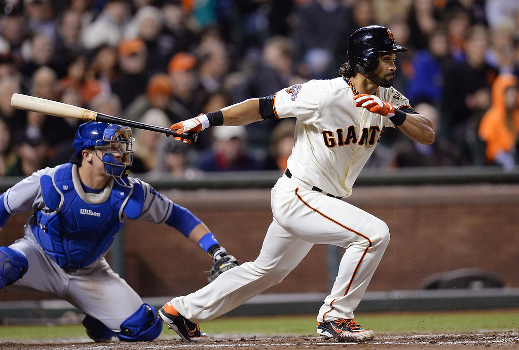 . SAN FRANCISCO, CA - SEPTEMBER 26:  Angel Pagan #16 of the San Francisco Giants grounds out to second base but drives in Nick Noonan #21 (not pictured) during the fifth inning against the Los Angeles Dodgers at AT&T Park on September 26, 2013 in San Francisco, California.  (Photo by Thearon W. Henderson/Getty Images)