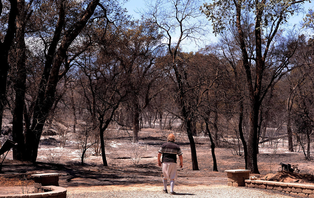 ". ""It was a wall of fire,\"" said James Goble, 63, as he assessed fire damage done by the Silver Fire just outside of his 3-acre property along Twin Pines Road in the mountains south of Banning August 8, 2013.   GABRIEL LUIS ACOSTA/STAFF PHOTOGRAPHER."