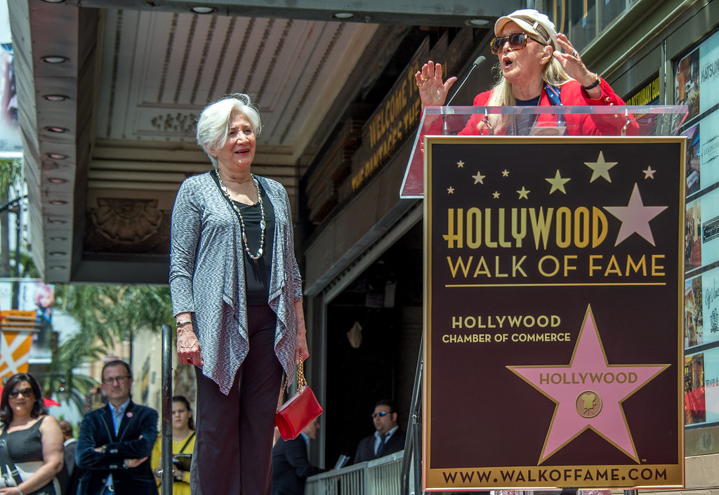 . Actress Olympia Dukakis (L) listens to actress Diane Ladd as they attend the ceremony honoring Dukakis with the 2,498th Star on The Hollywood Walk Of Fame on May 24, 2013 in Hollywood, California. (JOE KLAMAR/AFP/Getty Images)