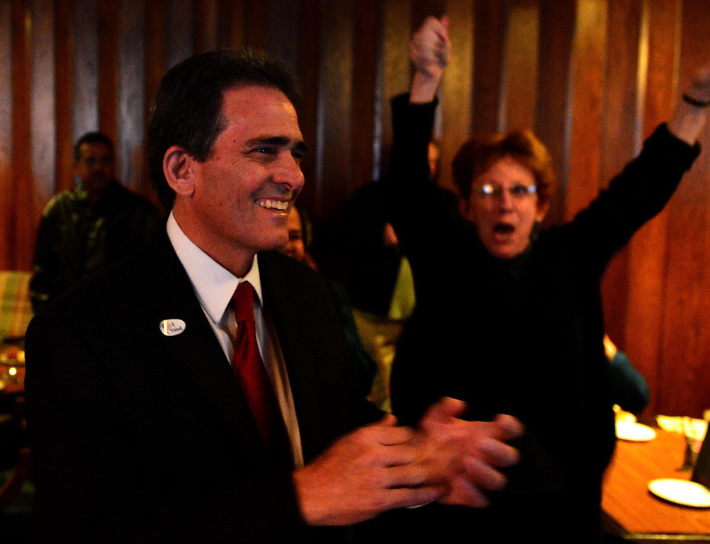 . San Bernardino Mayor-elect Carey Davis, left, is all smiles after learning he is up in points in absentee ballots, while supporter Stephani Congdon, of Rancho Cucamonga, reacts during election night Tuesday at Arrowhead Country Club in San Bernardino. LaFonzo Carter/The Sun