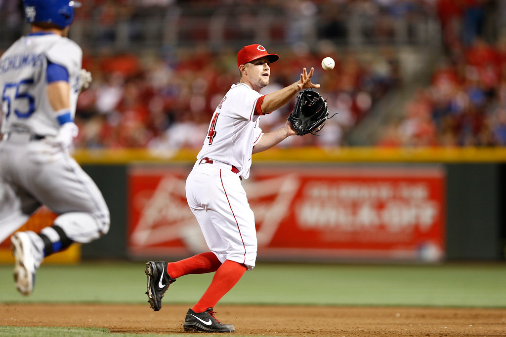 . CINCINNATI, OH - SEPTEMBER 6: Mike Leake #44 of the Cincinnati Reds makes a play after fielding the ball in front of the mound against the Los Angeles Dodgers at Great American Ball Park on September 6, 2013 in Cincinnati, Ohio. The Reds won 3-2. (Photo by Joe Robbins/Getty Images)