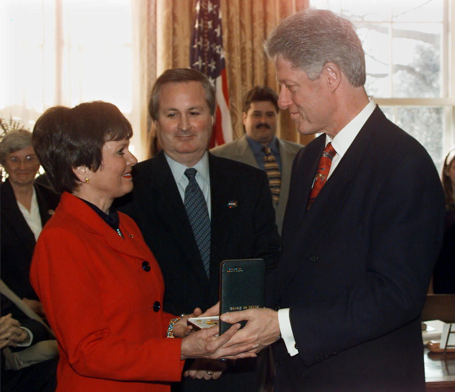 . President Clinton presents Martha Chaffee, widow of astronaut Lt. Commander Roger Chaffee with the Congressional Space Medal of Honor during a ceremony in the Oval Office of the White House Wednesday Dec. 17, 1997. Edward White III, who received the medal for his late father Edward White II looks on at center. White and Chaffee, along with Gus Grissom where killed Jan. 27, 1967 when a fire erupted on the launch pad during a preflight test for the Apollo 1 Moon mission. (AP Photo/Doug Mills)