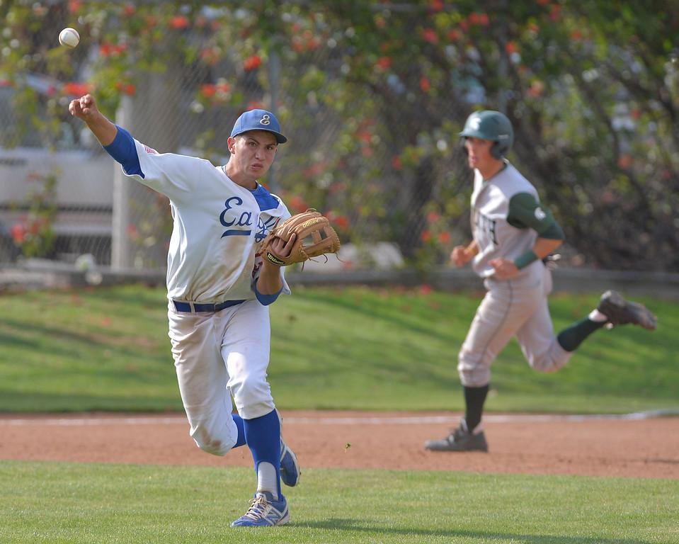 . 0509_SPT_TDB-L-SOUTH-ELSEG--- El Segundo, CALIFORNIA--5/8/13--- Staff Photo: Robert Casillas / LANG--- South Torrance defeated host El Segundo 6-3 in Pioneer League baseball game. Nick Martinez throws out runner at first.