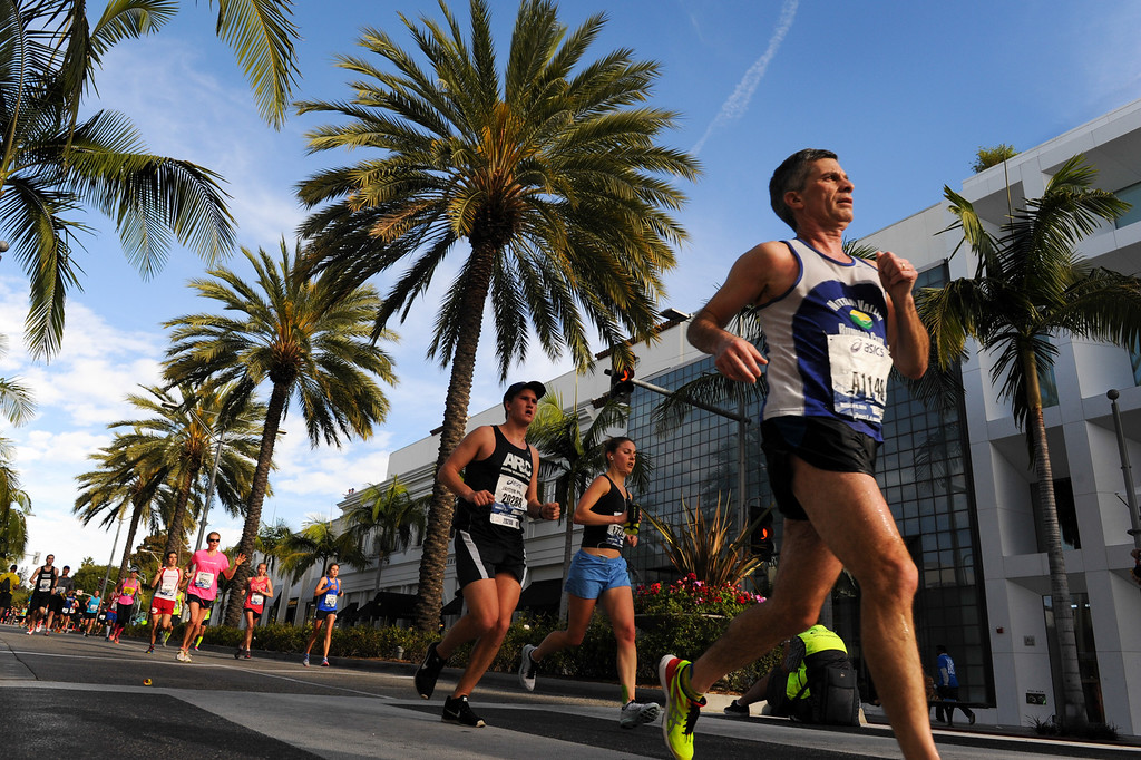 . Marathon runners cruise down Rodeo Drive in Beverly Hills during the Los Angeles Marathon, Sunday, March 9, 2014. (Photo by Michael Owen Baker/L.A. Daily News)