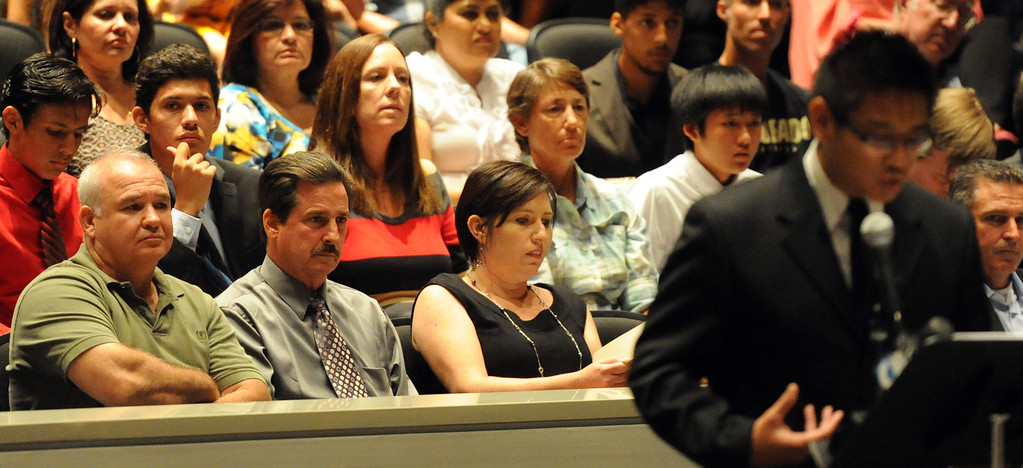 . Former cross-country coach James O\'Brien listens as Joshua Tran speaks about his former coach as over 200 people crowded the Arcadia Unified School District Performing Arts Center as a show of support for fired Arcadia High School cross-country coach James O\'Brien during a Arcadia Unified School District Board of Education meeting on Tuesday, July 23, 2013 in Arcadia, Calif. O\'Brien, led the team to two time state and national championships.