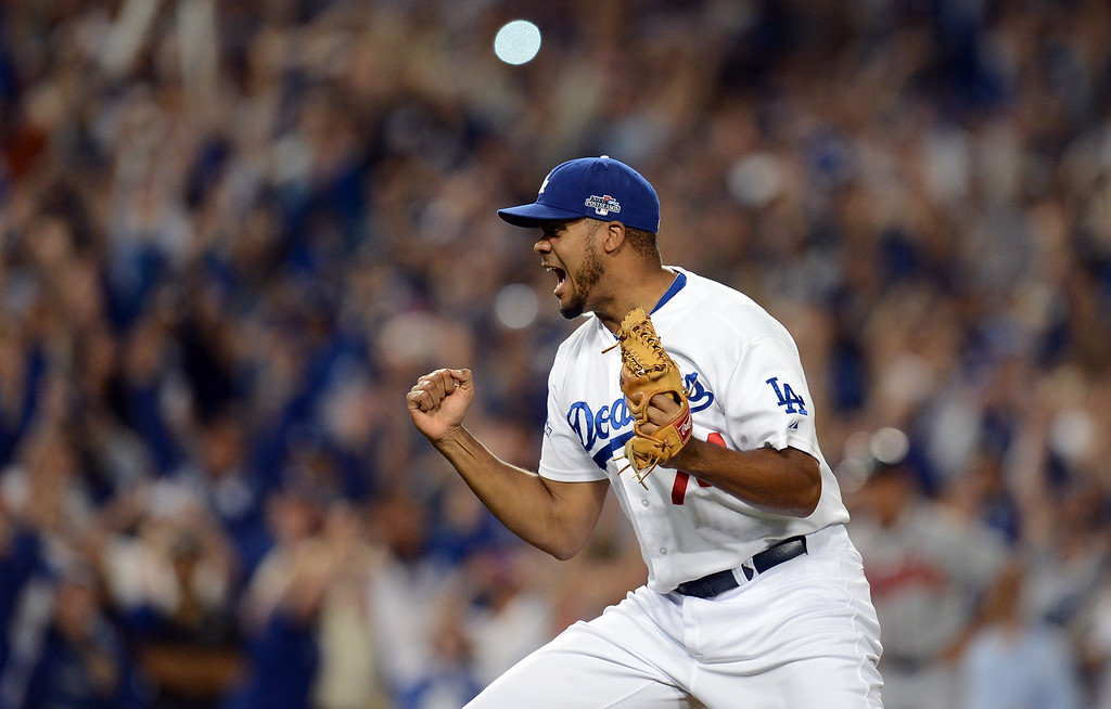 . The Dodgers\' Kenley Jansen reacts after the final out against  the Atlanta Braves during game 4 of the NLDS at Dodger Stadium Monday, October 7, 2013. The Dodgers beat the Braves 4-3.(Photo by Hans Gutknecht/Los Angeles Daily News)