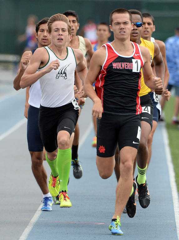 . Bonita\'s Beckhum Dillon, left, along with Harvard Westlake\'s David Manahan competes in the division 3 800 meters race during the CIF Southern Section track and final Championships at Cerritos College in Norwalk, Calif., Saturday, May 24, 2014. 