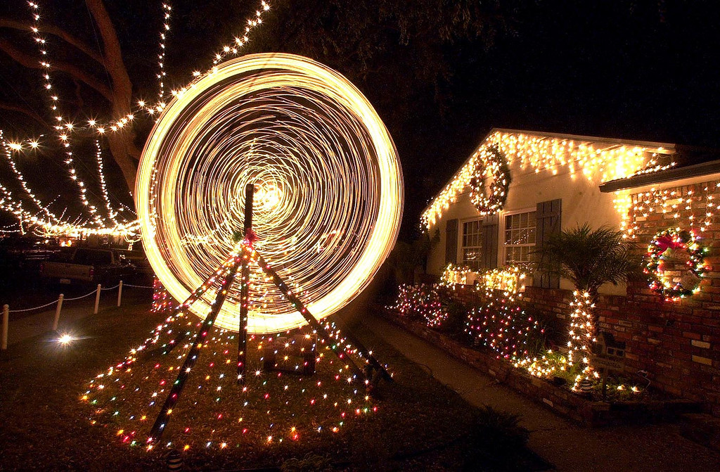 """. Breeze photo by Bruce Hazelton - 12/6/00 - A lighted ferris wheel spins on front lawn of home on___________in \""""Sleepy Hollow\"""", an area in South Torrance where homes have elaborate light displays."""