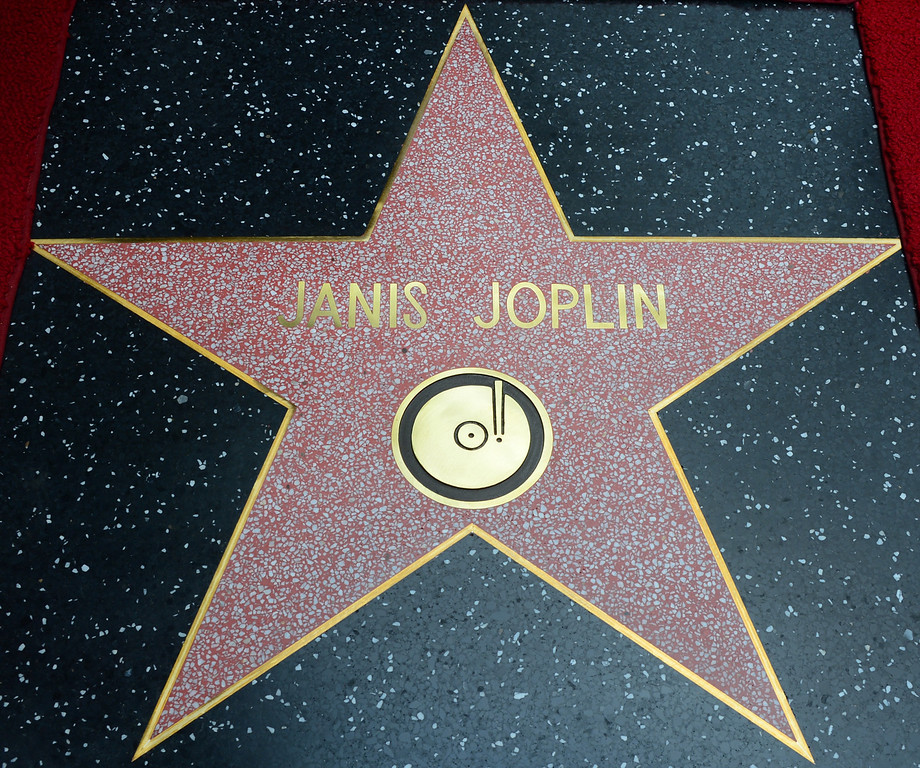 . The Janis Joplin \'Star\' is unveiled during a posthumous Hollywood Star ceremony on November 4, 2013 in Hollywood, California. Joplin, who had her siblings Michael and Laura at the ceremony, would have turned 70 years old this year and is the recipient of the 2,510th Star on the Hollywood Walk of Fame in the Category of Recording.         (FREDERIC J. BROWN/AFP/Getty Images)