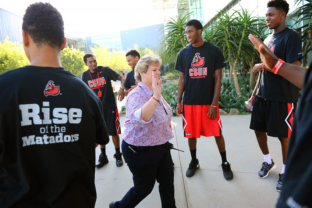. Members of CSUN\'s mens basketball team greet guests prior to President Dianne F. Harrison third annual convocation address Thursday, August 21, 2014.(Andy Holzman/Daily News Staff Photographer)
