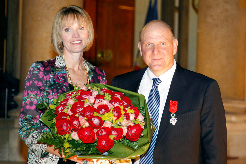 . Microsoft CEO, Steve Ballmer, right, and his wife Connie pose on the steps of the Elysee Palace after he was awarded Knight of the Legion of Honor by France\'s President Nicolas Sarkozy, unseen, in Paris, Wednesday, Feb. 16, 2011. (AP Photo/Francois Mori, Pool)