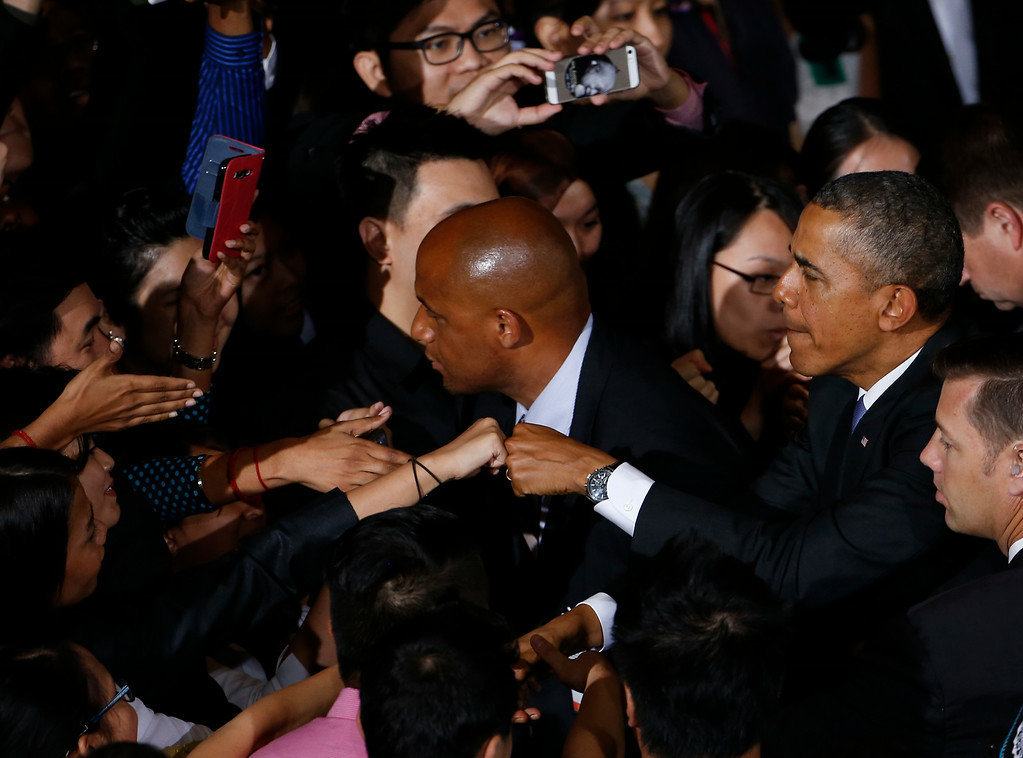 ". U.S. President Barack Obama ""fist bumps\"" an audience member after a town hall style event at the University of Malaya with participants in the Young Southeast Asian Leaders Initiative in Kuala Lumpur, Malaysia, Sunday, April 27, 2014. With the first visit to Malaysia by a U.S. president in nearly half a century, Obama holds economic and security talks with Malaysian Prime Minister Najib Razak, who leads a southeast Asian nation with an important role in Obama\'s efforts to forge deeper ties with the region. (AP Photo/Charles Dharapak)"