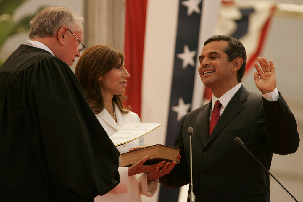 . 7/1/05-LOS ANGELES- Antonio Villaraigosa takes the oath of office as he is inaugurated as Mayor of the city of Los Angeles Friday at City Hall. He was sworn in by Justice Stephen Reinhardt, from the United States Court of Appeals for the Ninth Circuit, with his wife Corina by his side.   (Los Angeles Daily News file photo)